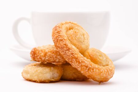 Fresh homemade pastry, cookies, close-up shot, white tea cup at background 版權商用圖片 - 10997556