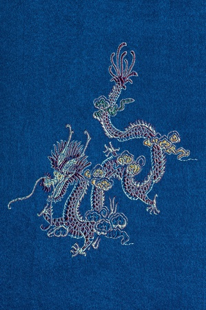 Chinese dragon embroidered on a blue silk photo
