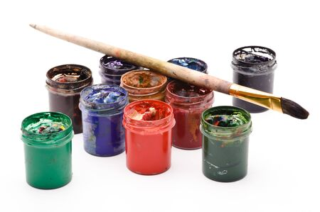 Goup of opened cans with multicolored paints, and brush, white background photo