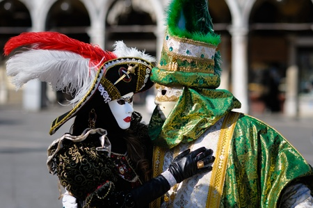masquerader: Traditional Venetian carnival costumes at the San Marco Square Stock Photo