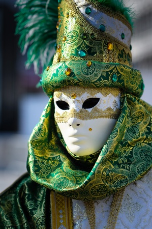 Traditional Venetian carnival costume at the San Marco Square photo