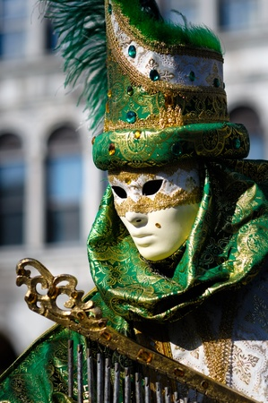 masquerader: Traditional Venetian carnival costume at the San Marco Square