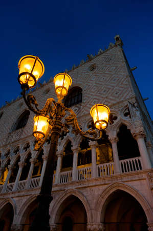 crepuscle: Evening at San Marco square  Doge s Palace and antique street-lamp