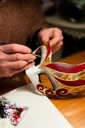 Woman hands with venice carnival mask, painting, making of mask decoration