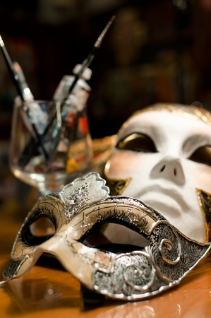 venetian mask: Still-life with two venice carnival masks, paints and brushes Stock Photo
