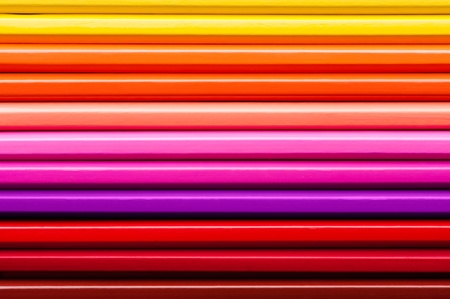 Set of multicolor pencils, abstract striped background photo