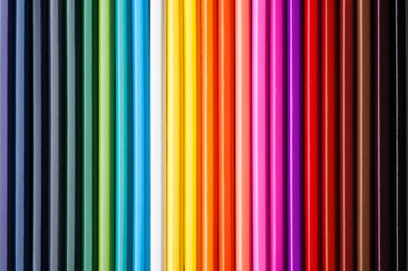 Set of multicolor pencils, abstract striped background