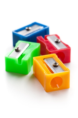 colored school: Group of multicolor pencil sharpeners, close-up shot, isolated on white background