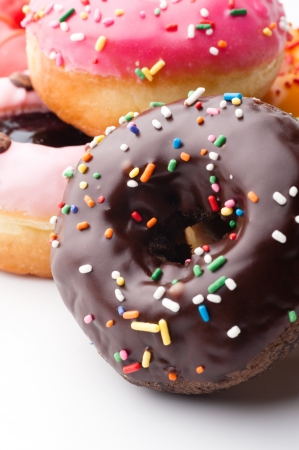 Group of glazed donuts, isolated on white background