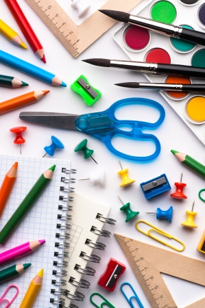 Assortment of various school items, white background