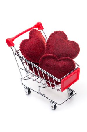 Shopping cart, full of red hearts, isolated on white background Stock Photo - 15588221