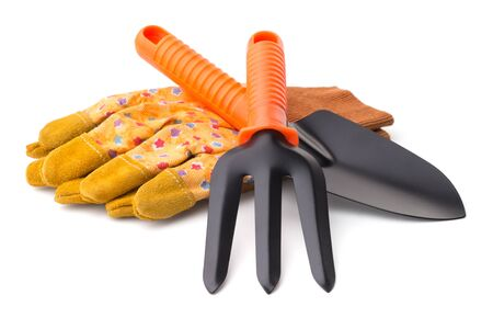 Gardening: yellow protective gloves, trowel and digging fork, isolated on white background photo