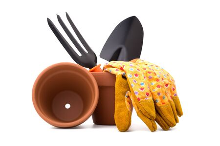 Gardening: group of tools and accessories (gloves, flower pot, trowel and digging fork), isolated on white background photo