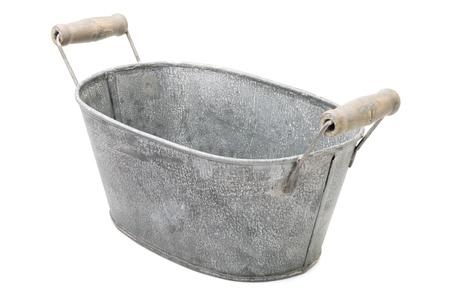 Houseware: old, time-worn, rusty zinc-coated washbowl, isolated on white background