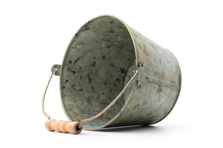 Houseware: old, time-worn, rusty zinc-coated bucket, isolated on white background Stock Photo
