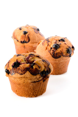 Bread and bakery: group of fresh blackcurrant muffins, isolated on white background