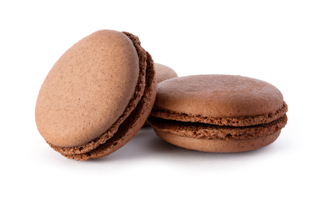Food  group of fresh chocolate macarons, isolated on white background photo