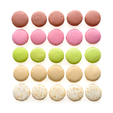 Food: multicolored macarons assortment, arranged in rows, isolated on white background photo