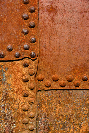 riveted metal: Backgrounds and textures: rusty metal surface with riveted joints, industrial abstract
