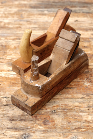 Backgrounds and textures: two old carpenters planes on a wooden workbench
