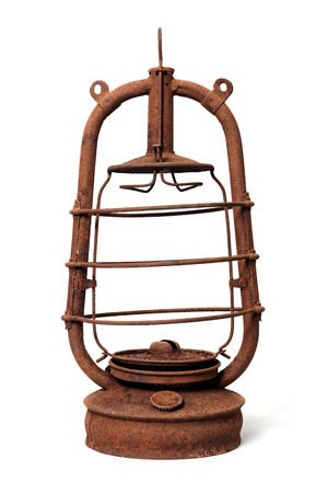 Isolated objects: very old shabby and rusty kerosene lamp, without glass, on white background