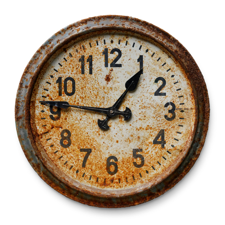 Very old worn and rusty round wall clock, isolated on white background