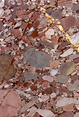 Backgrounds and textures: surface of beautiful pink decorative stone, abstract pattern of cracks, spots and stains, natural background Stock Photo