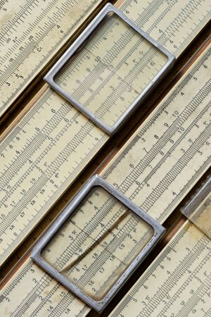 Backgrounds and textures: group of old slide rules, or slipsticks, retro science abstract