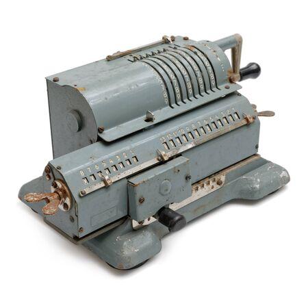 Isolated objects: grey vintage mechanical pinwheel calculator, on white background