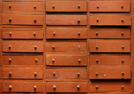 Backgrounds and textures: old brown wooden closet with drawers, close-up shot