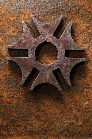 Backgrounds and textures: rusty steel six-pointed star or cross, on heavily corroded metal surface