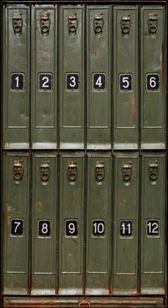 Backgrounds and textures: old green metal cabinet with vertical storage compartments, front view, close-up shot