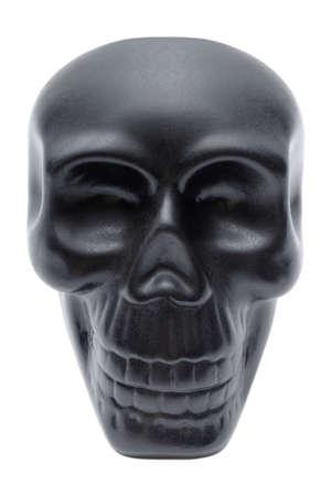 Single black human skull, plastic model, souvenir, isolated on white background 版權商用圖片