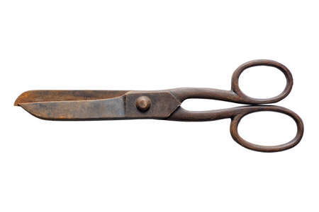 Old rusty scissors, closed, isolated on white background