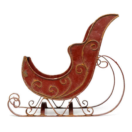 Old emty red sleigh toy, vintage seasonal Christmas metal decoration, isolated on white