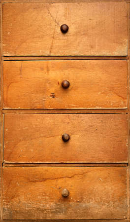 Backgrounds and textures: old wooden cabinet with drawers, front view, close-up shot