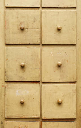 Backgrounds and textures: old wooden cabinet with drawers, front view