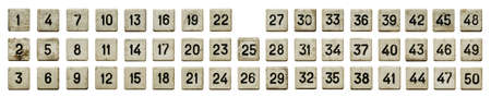 Very old numeric keypad, set of white plastic buttons, numbered from 1 to 50, isolated on white background
