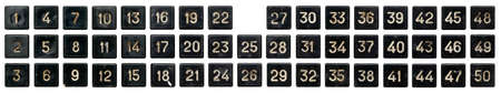 Very old numeric keypad, set of black plastic buttons, numbered from 1 to 50, isolated on white background