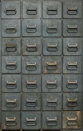 Backgrounds and textures: old gray metal cabinet with drawers, front view, close-up shot