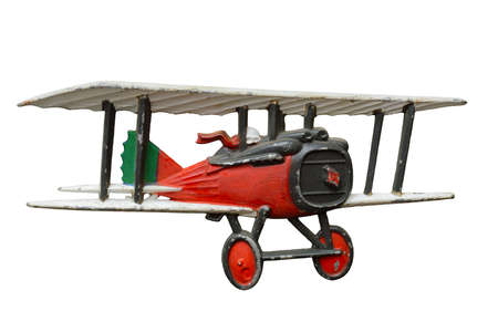 Antique embossed relief decoration, generic Great War (First World War) red toy airplane, isolated on white background