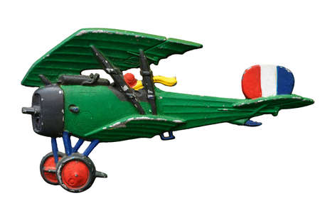 Antique embossed relief decoration, generic Great War (First World War) green toy airplane, isolated on white background 版權商用圖片
