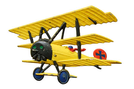 Antique embossed relief decoration, generic Great War (First World War) yellow toy airplane, isolated on white background 版權商用圖片