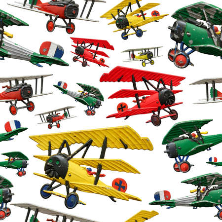 Assorted set of generic vintage First World War toy airplanes, various colors, isolated on white background, seamless pattern