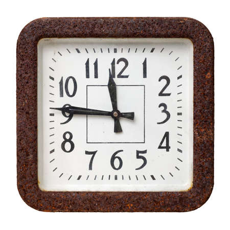 Very old retro rectangular wall clock, with white face and heavily corroded metal frame, isolated on white background 版權商用圖片