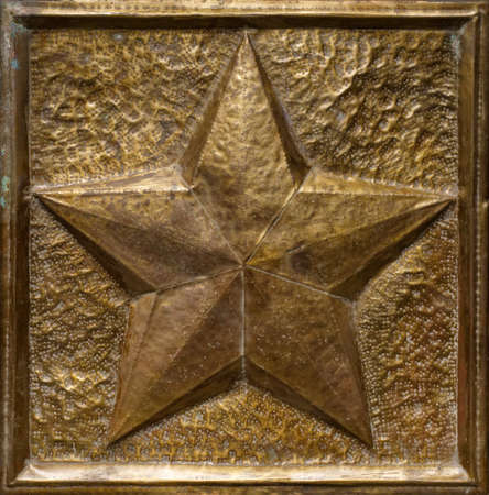 Old embossed work, yellow metal incuse, five-pointed star