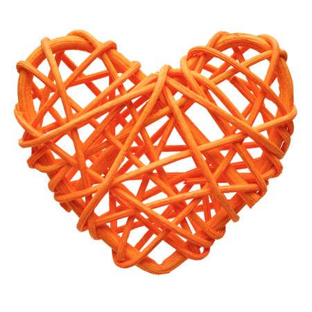 Orange heart, handmade wicker decoration, isolated on white background 版權商用圖片