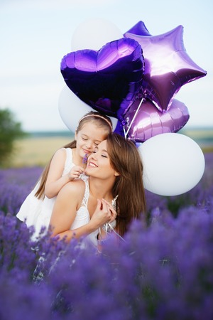 Mom and Daughter in the lavender field.