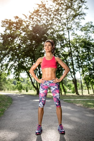 Attractive fitness young woman rest after running in the park. Sport motivation. 写真素材