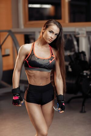 Young woman posing in the gym.